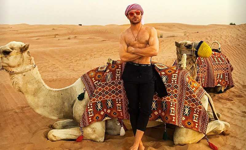 zac-efron-riding-a-camel-shirtless-is-everything-you-dreamed-it-would-be-05