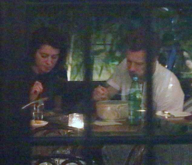 469D53AA00000578-5109449-The_couple_paused_to_focus_on_their_dinner-m-97_1511395276536