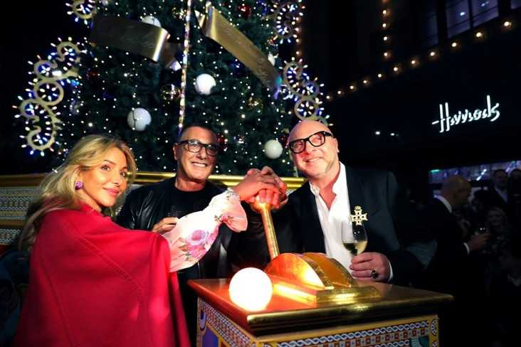 Domenico Dolce, Stefano Gabbana, and Harrods chief merchant Helen David began by firing up the lights on a Dolce & Gabbana–decorated Christmas tree
