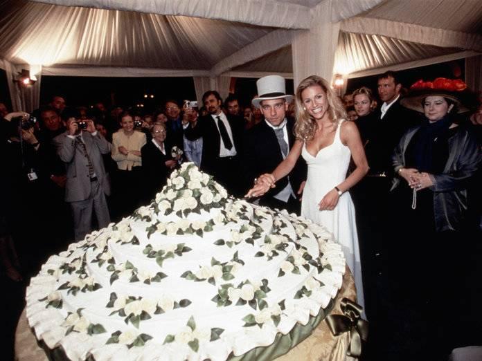 Cutting the cake at the wedding of Eros Ramazzotti and Michelle Hunziker